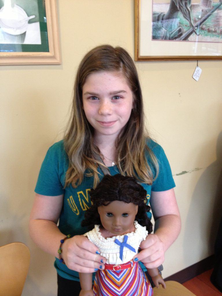 Avery and one of her dolls
