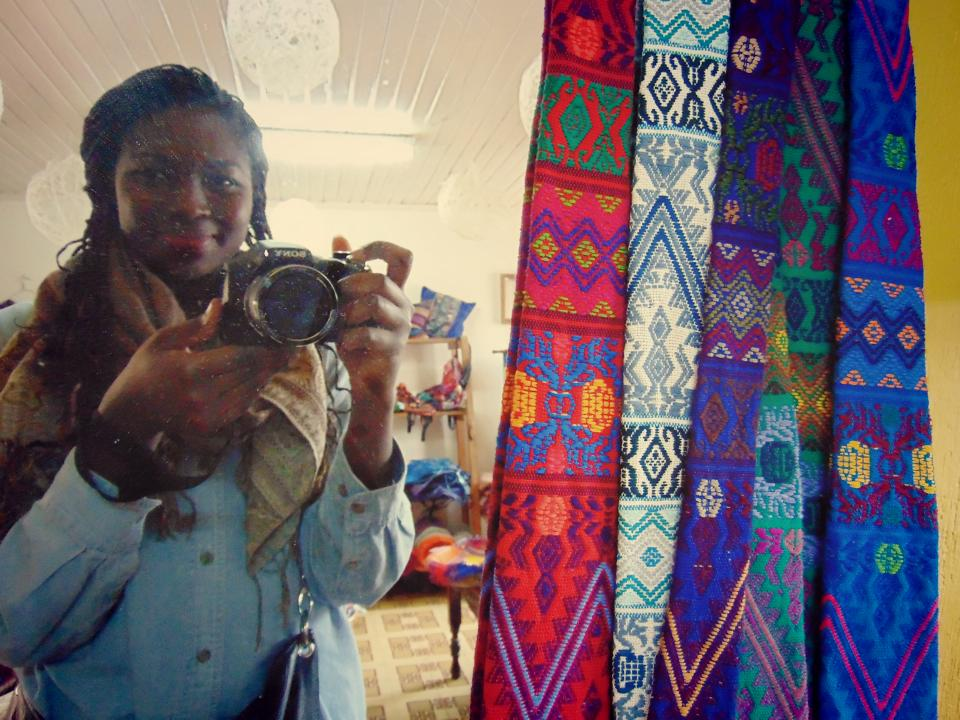 Dianne with several hand-woven pieces